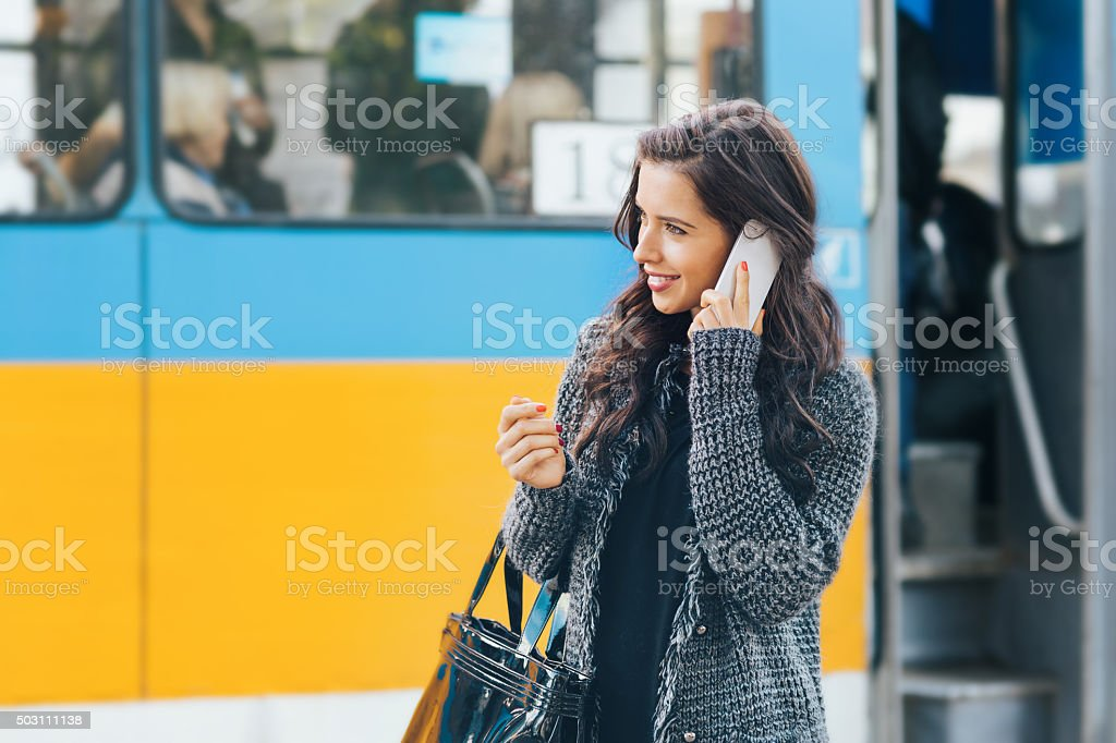 Pretty girl talking on cell phone stock photo