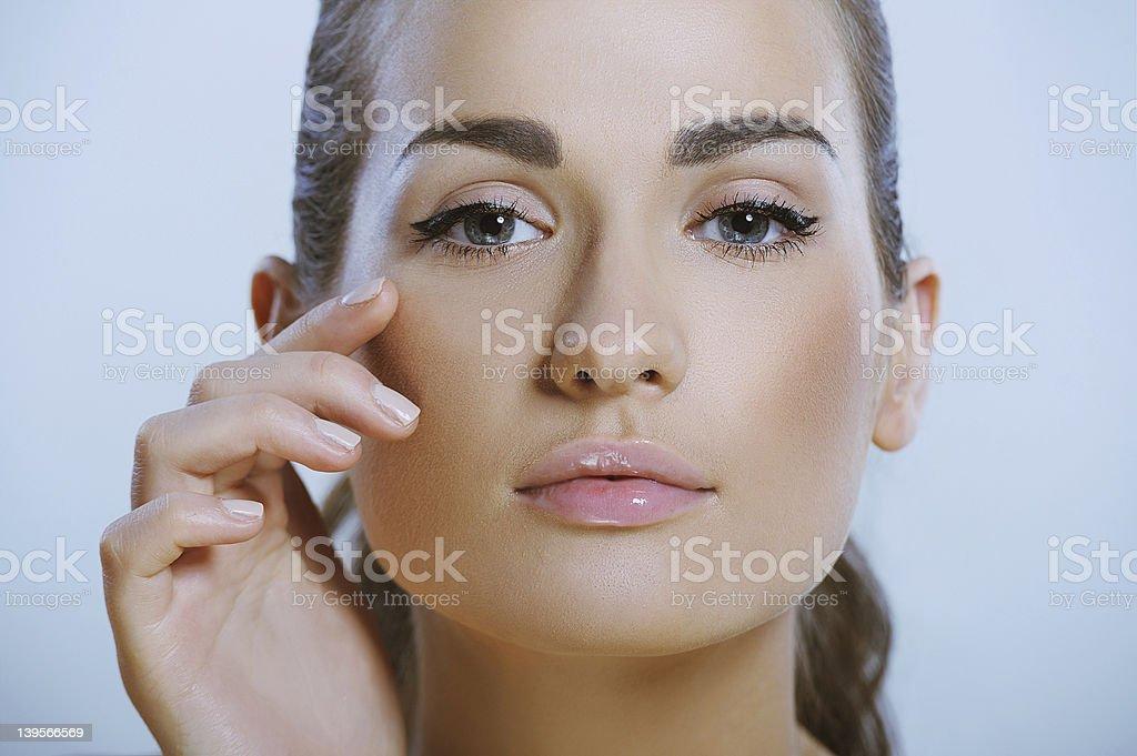 pretty girl touches the skin around eye royalty-free stock photo