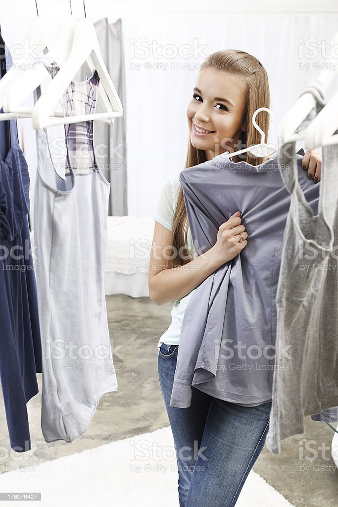 Pretty girl trying royalty-free stock photo