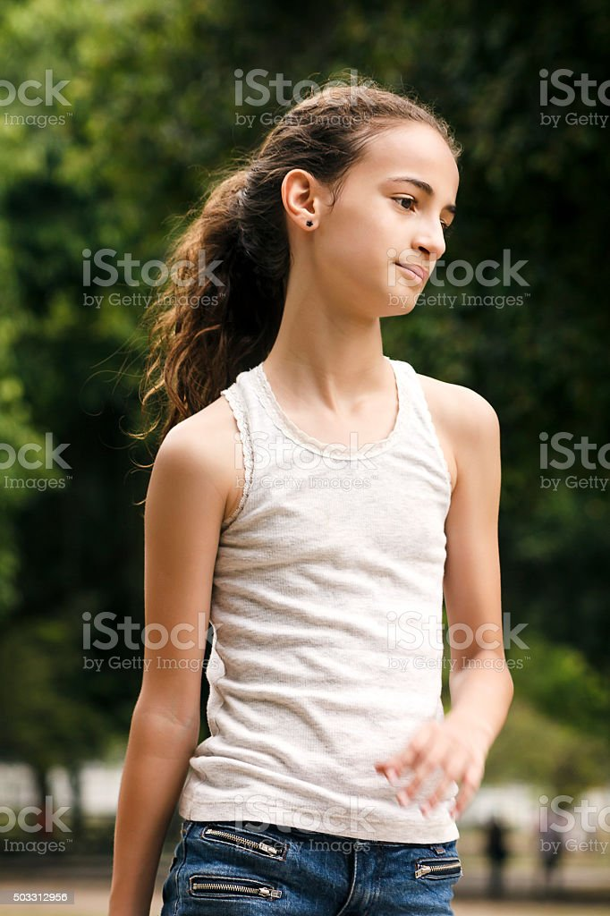 Pretty Girl Walking on Park on Weekend stock photo