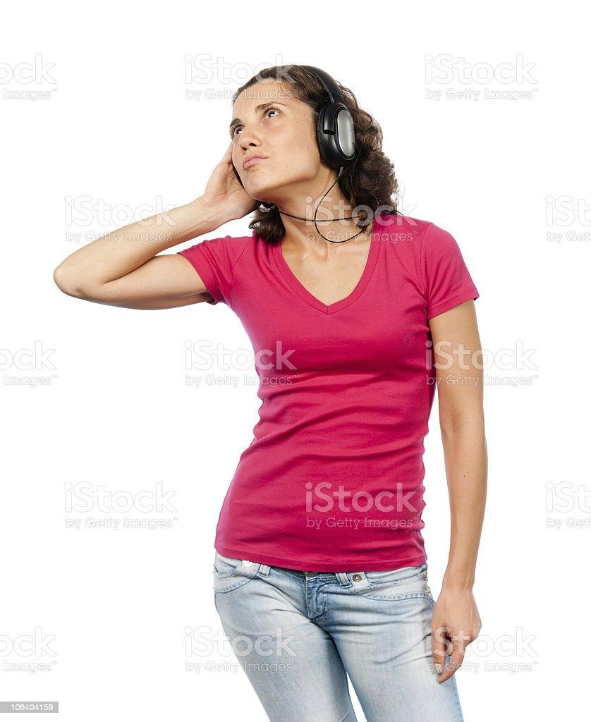 Pretty girl whith headphones enjoys music royalty-free stock photo