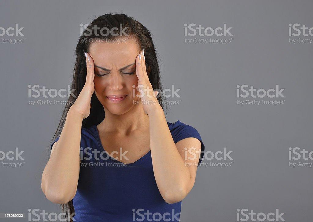 Pretty girl with a headache royalty-free stock photo