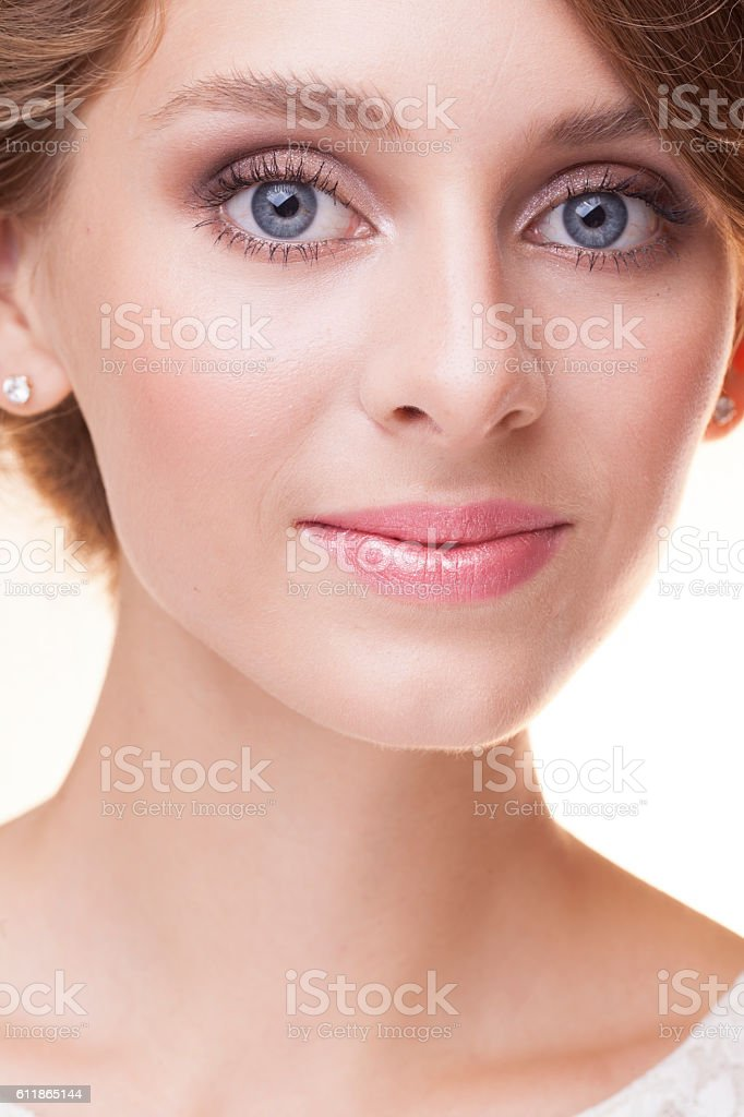 pretty girl with big eyes smiling close up stock photo