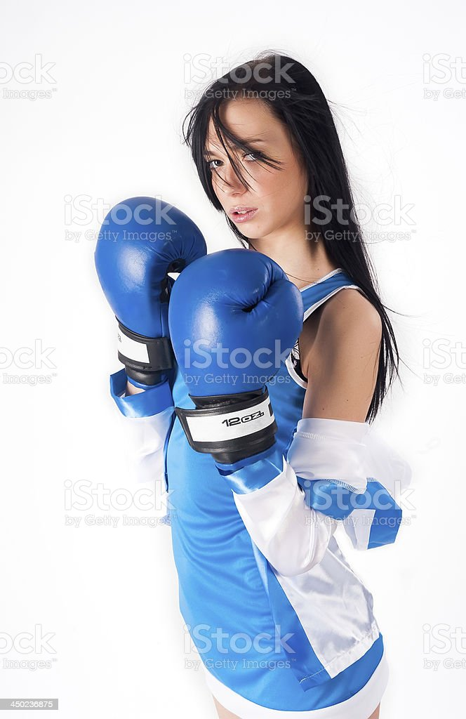 Pretty girl with boxing gloves royalty-free stock photo