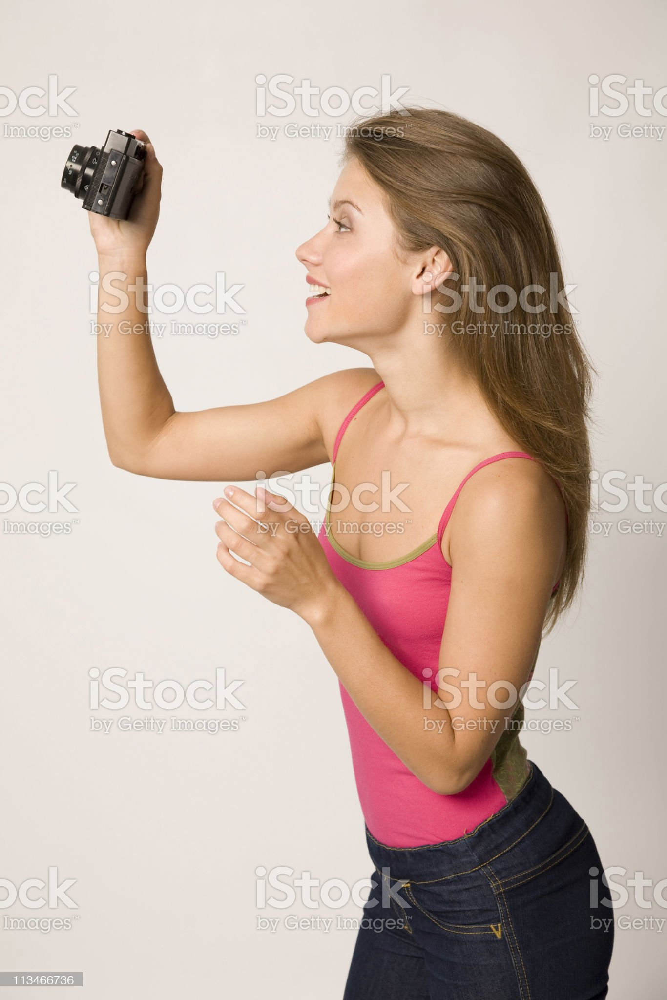 Pretty girl with camera. royalty-free stock photo