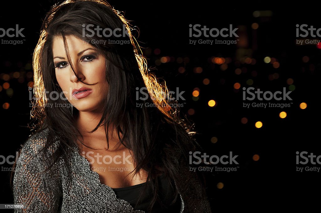 Pretty Girl with city lights in background stock photo