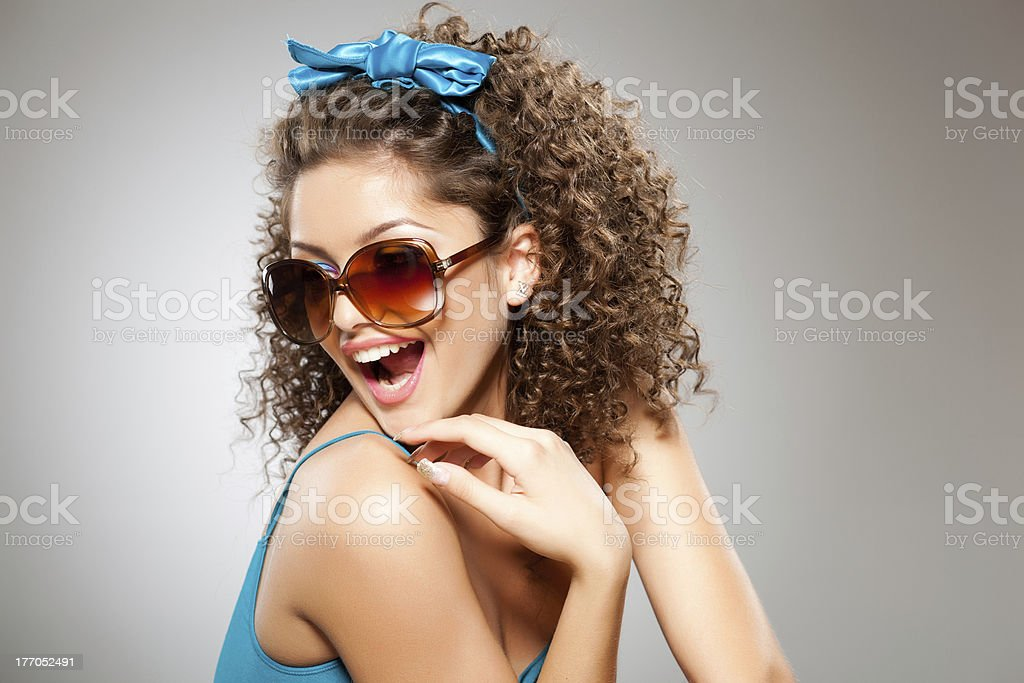 pretty girl with curly hair and perfect teeth royalty-free stock photo