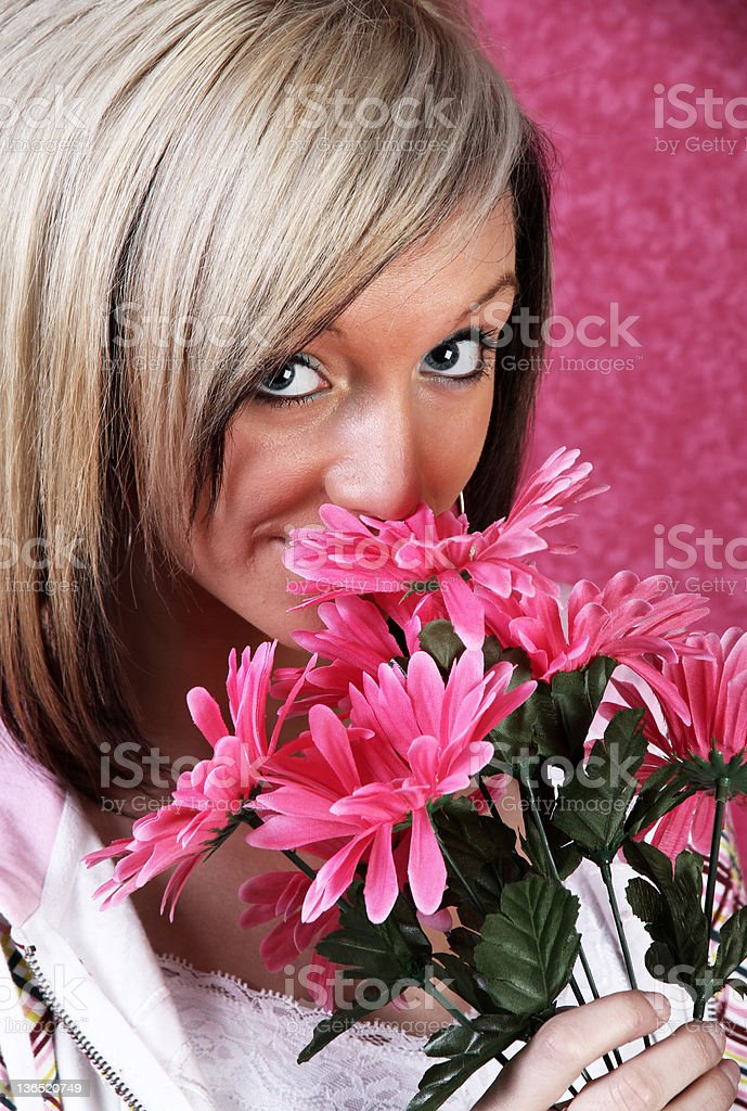 Pretty girl with flowers stock photo
