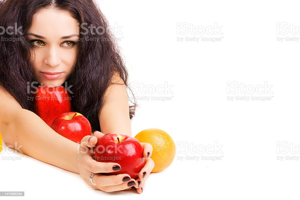 Pretty girl with fresh red apples and orange royalty-free stock photo