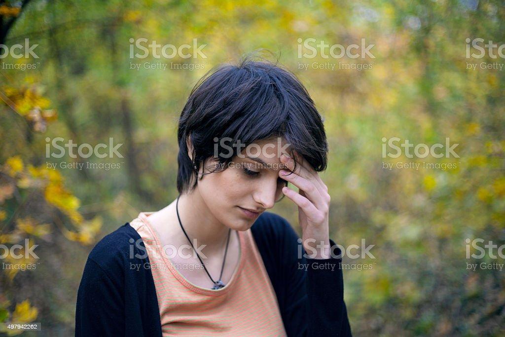 Pretty girl with headache royalty-free stock photo