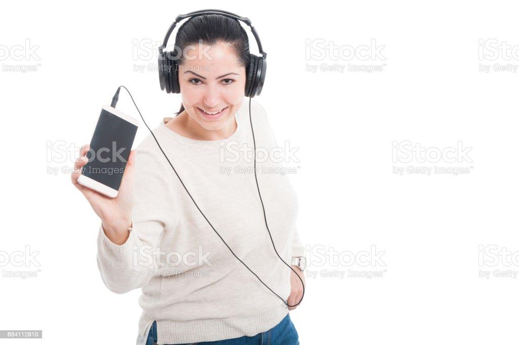 Pretty girl with headphones listening music stock photo