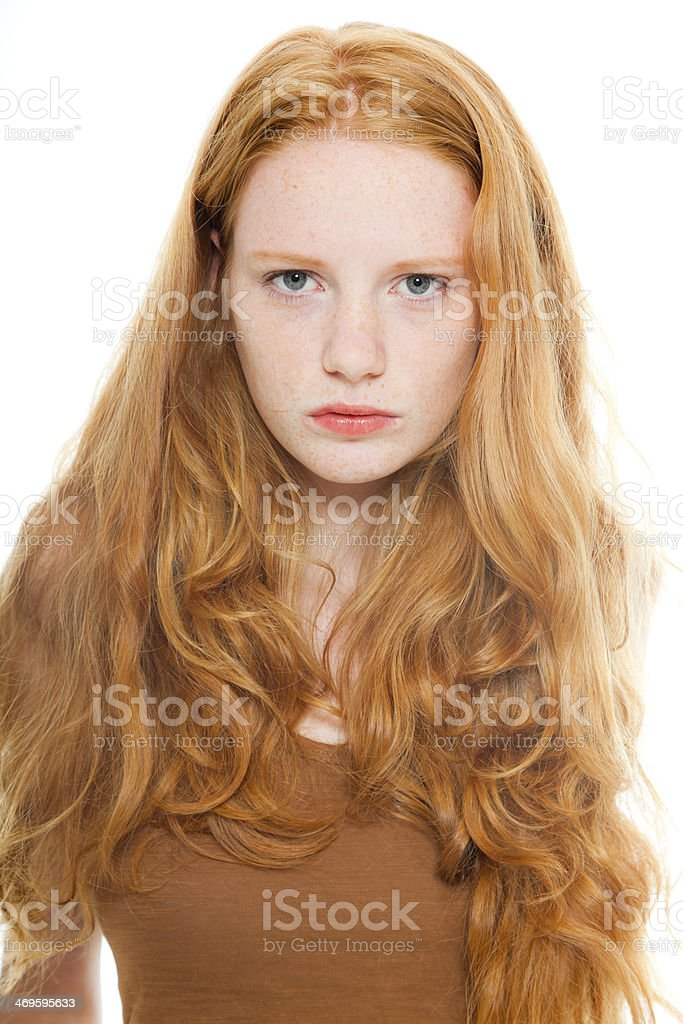 Pretty girl with long red hair wearing brown shirt. royalty-free stock photo