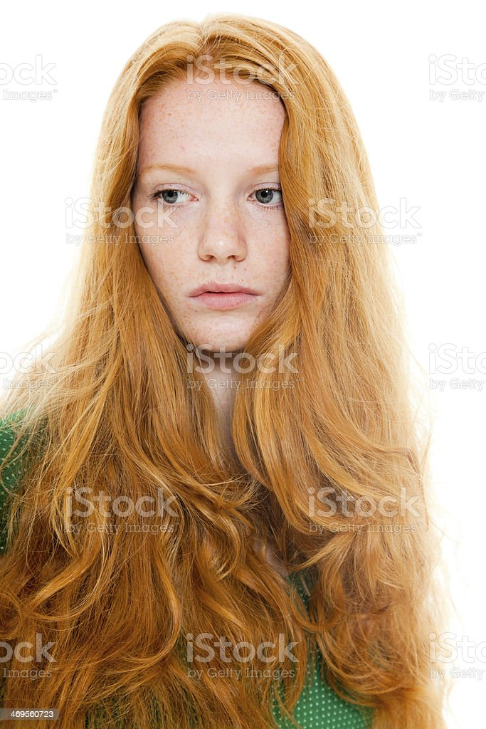 Pretty girl with long red hair wearing green shirt. royalty-free stock photo