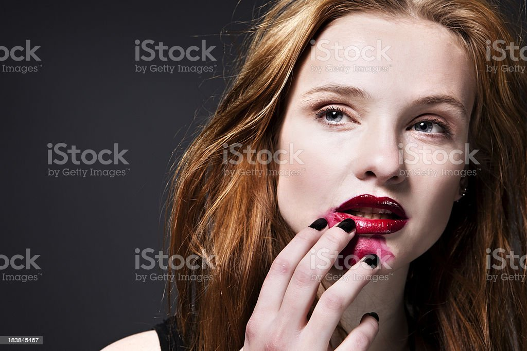 Pretty girl with smudged makeup royalty-free stock photo