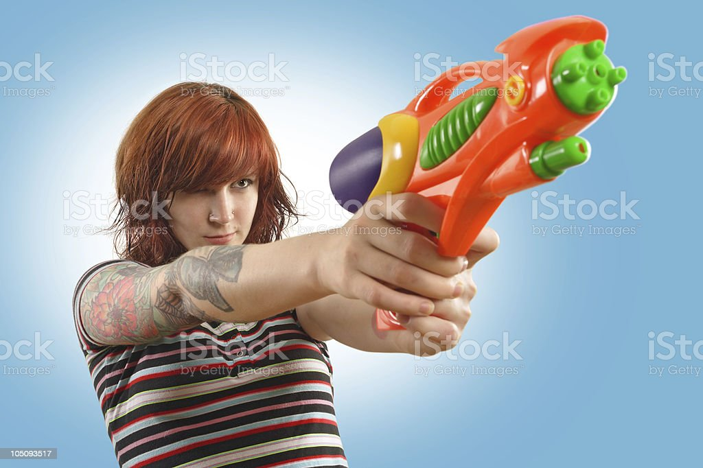 Pretty girl with squirt gun royalty-free stock photo