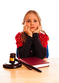 Pretty happy little  girl and law gavel isolated