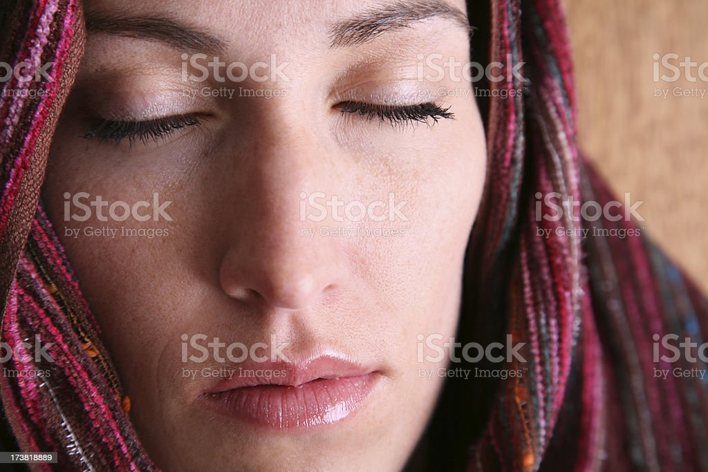 Pretty Headscarfed Woman With Eyes Closed stock photo
