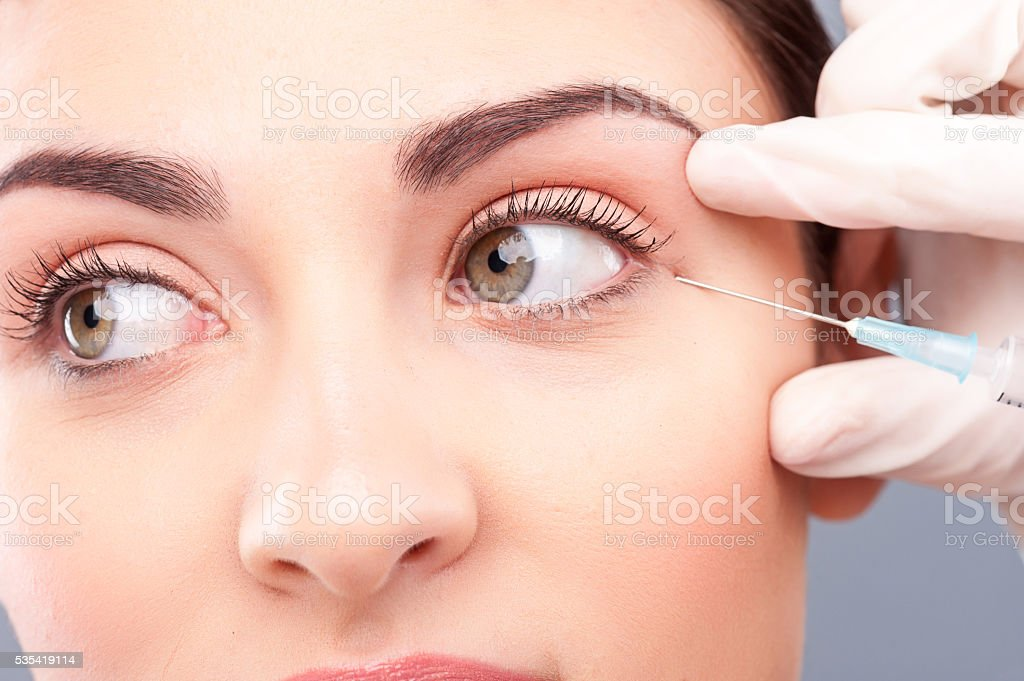 Pretty healthy girl is receiving facial treatment stock photo