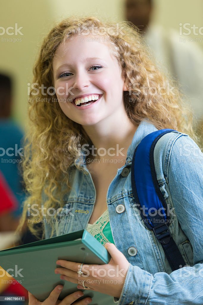 Pretty high school student entering science classroom royalty-free stock photo