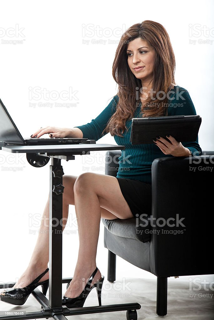 Pretty hispanic businesswoman in her forties royalty-free stock photo