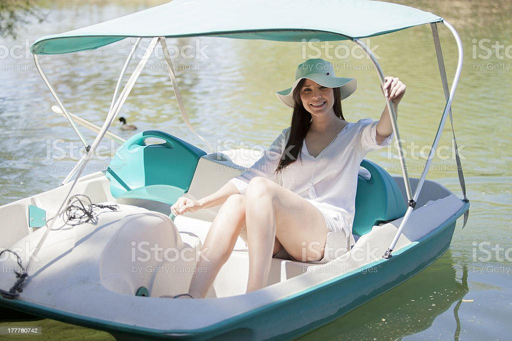 Pretty Hispanic girl on a pedal boat stock photo