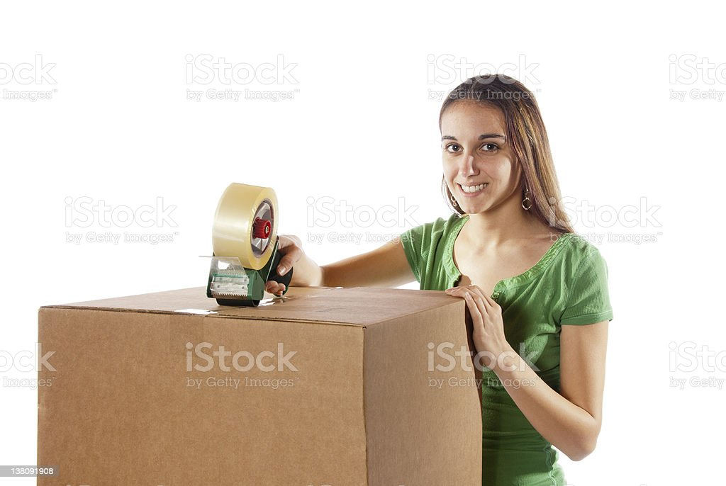 Pretty homemaker packing to move new house. royalty-free stock photo