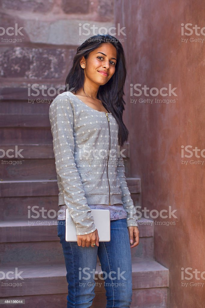Pretty Indian student on staircase stock photo