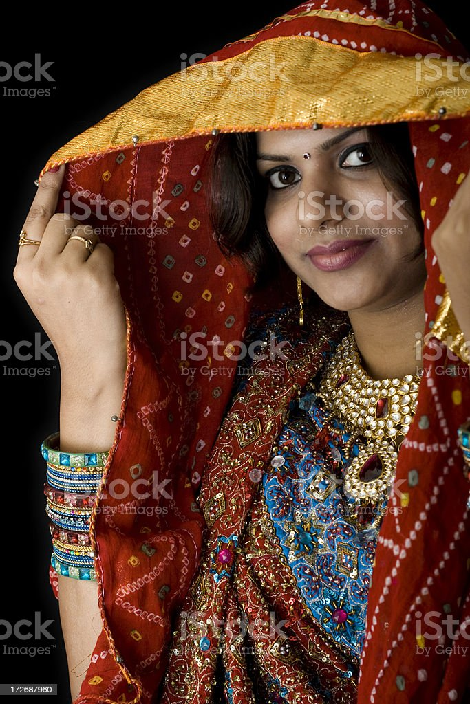 Pretty Indian Woman in colorful traditional clothing royalty-free stock photo