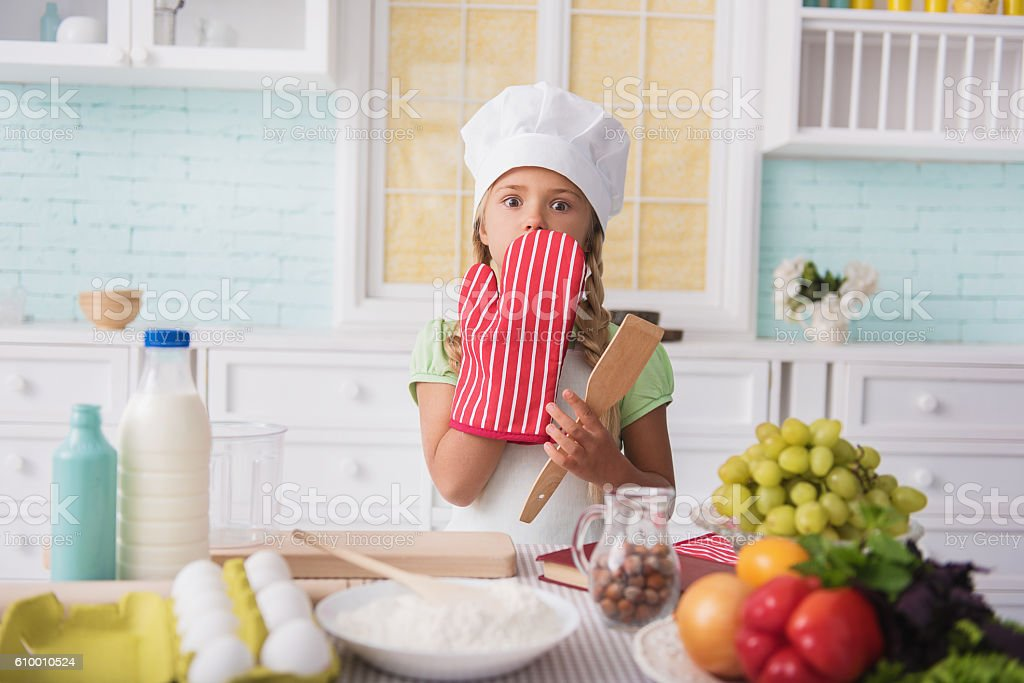 Pretty kid did something wrong in culinary stock photo