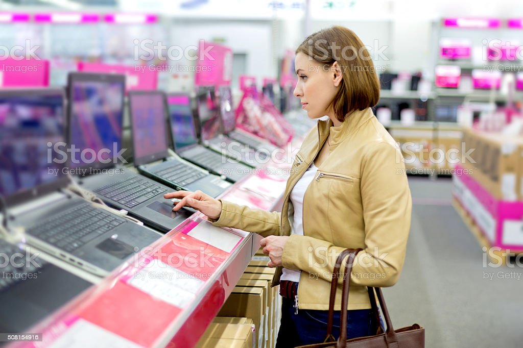 Pretty lady in retail computer store stock photo