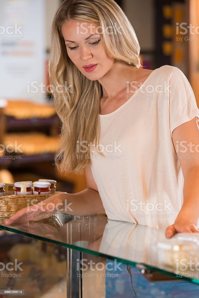 Pretty lady in the store stock photo