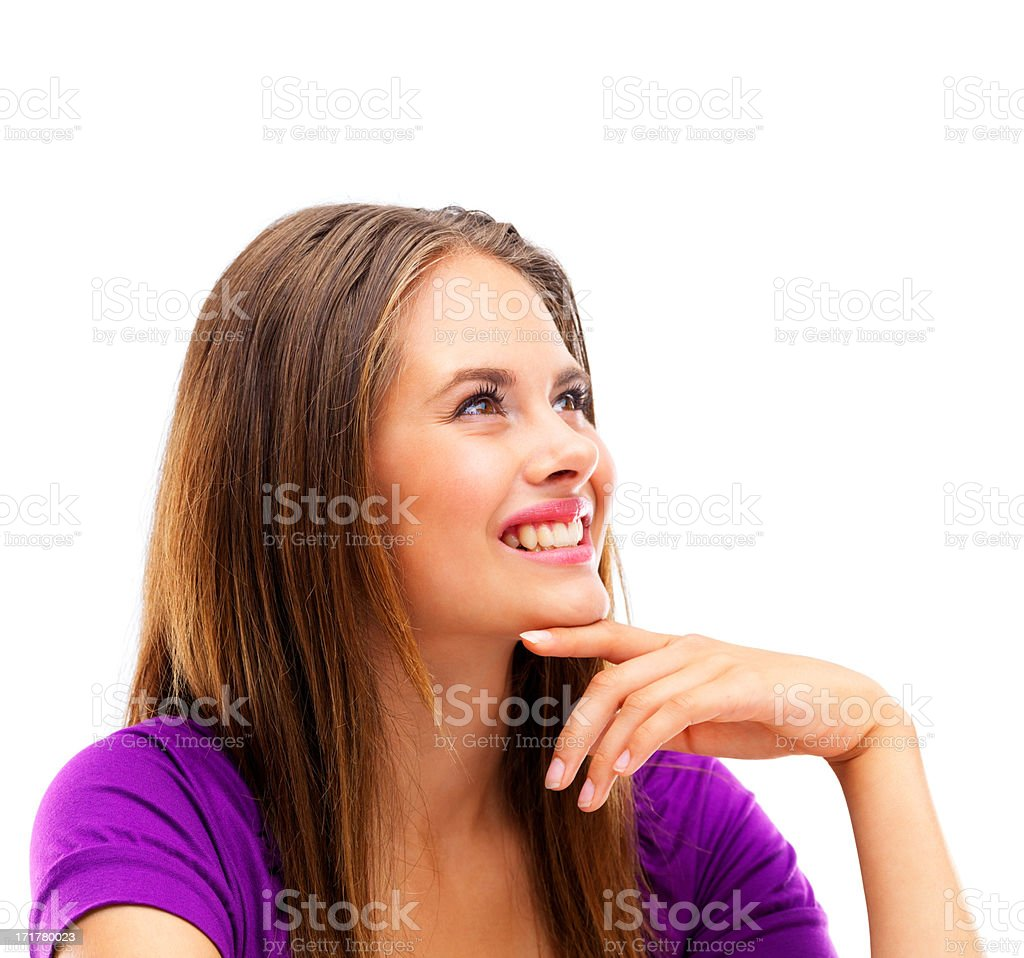 Pretty lady lost in thought smiling on white background stock photo