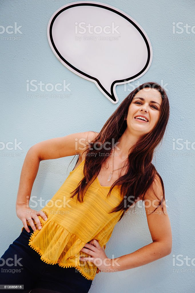 Pretty lady with beautiful smile and speech bubble stock photo