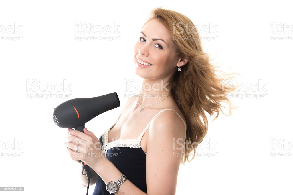 Pretty lady with flying from fen hair stock photo