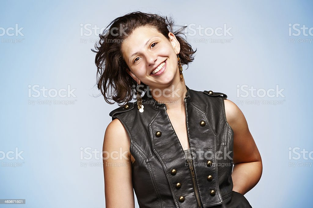 Pretty, laughing brunette in leather waistcoat stock photo