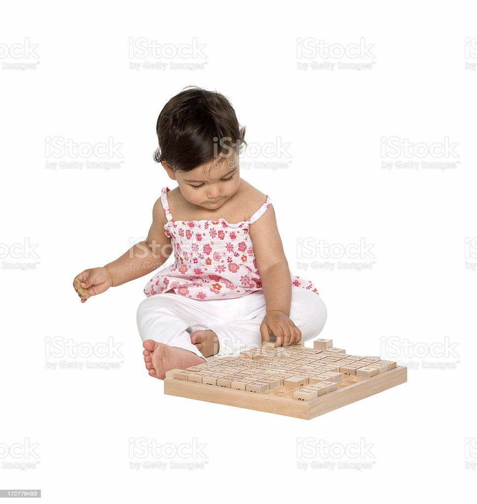 pretty little baby playing royalty-free stock photo