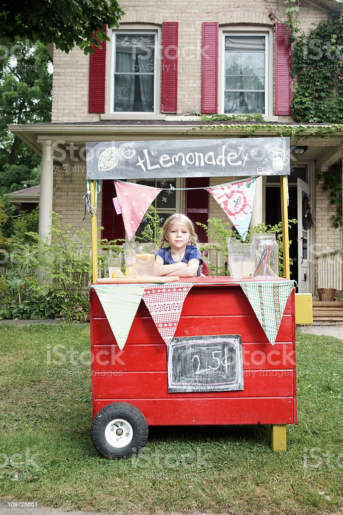 Pretty little girl and her lemonade stand. royalty-free stock photo
