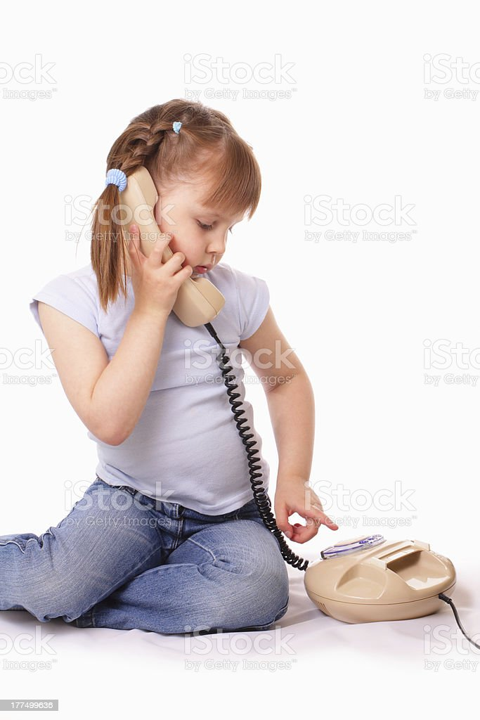 Pretty little girl dials the number stock photo