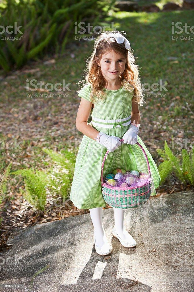 Pretty little girl holding easter egg basket royalty-free stock photo