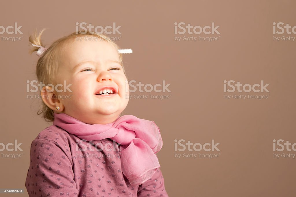 Pretty little girl laughing stock photo