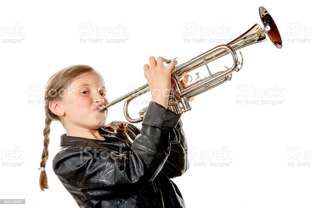 pretty little girl with a black jacket plays the trumpet stock photo
