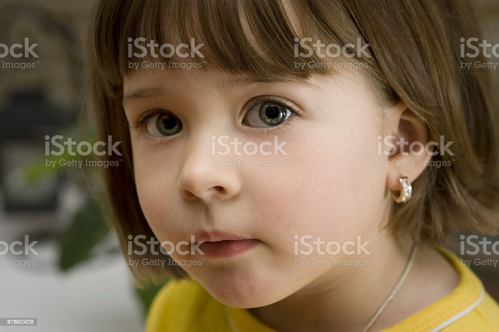 Pretty little girl with an earring stock photo