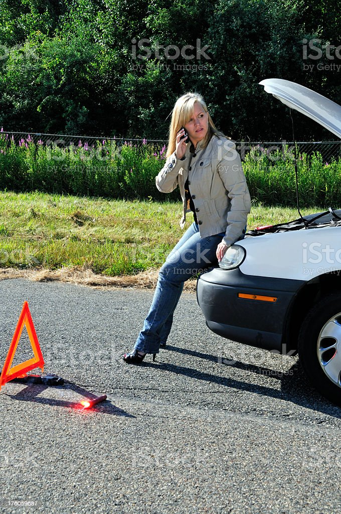 Pretty, Lone Woman Waits for Tow Truck royalty-free stock photo