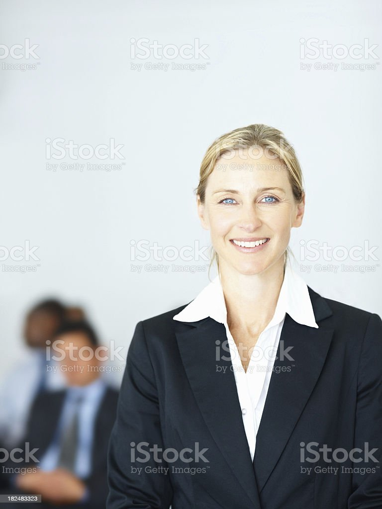 Pretty mature business woman with people at the background royalty-free stock photo