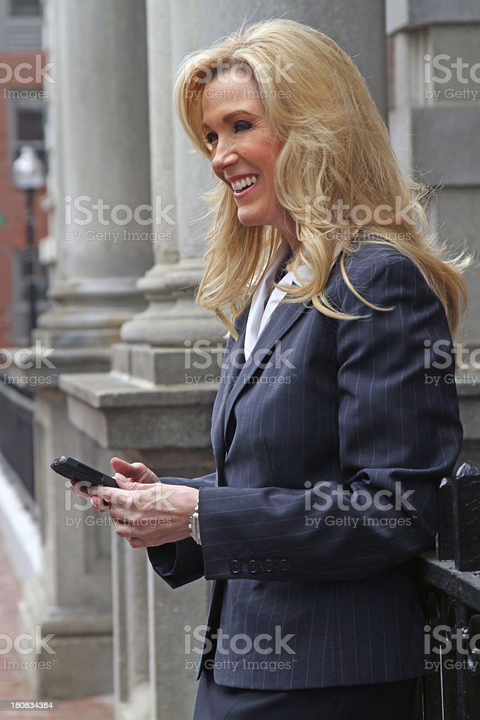 Pretty mature businesswoman laughing royalty-free stock photo