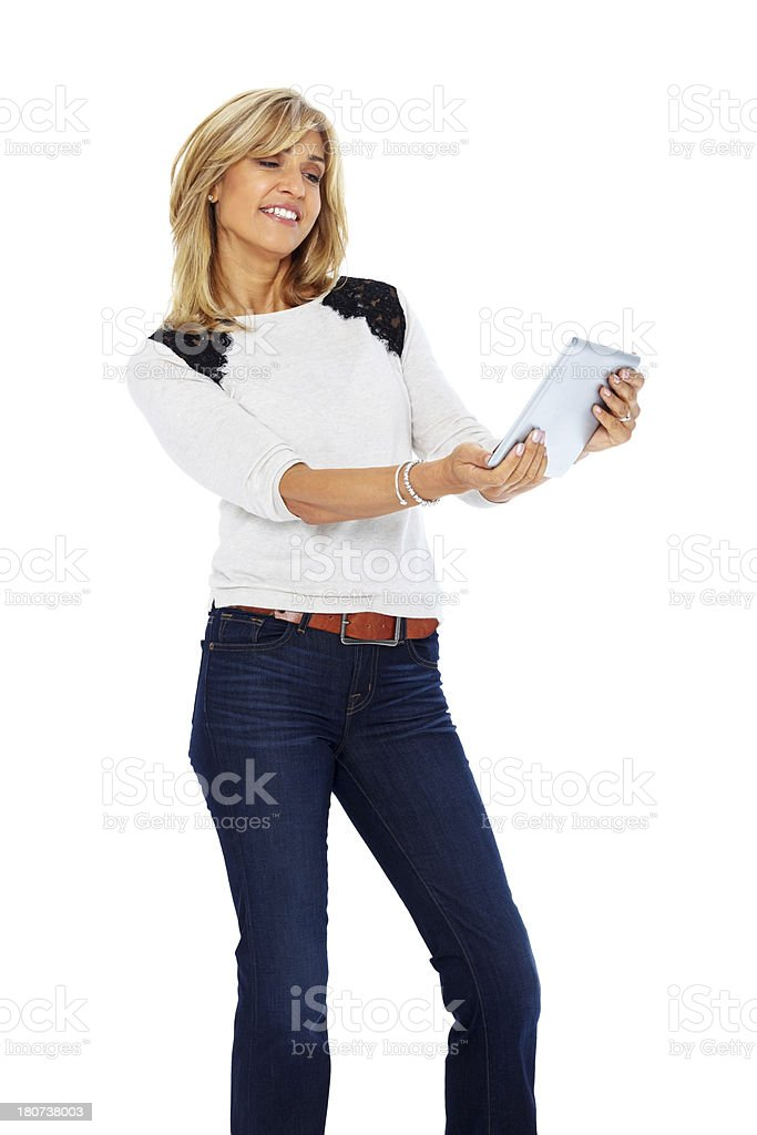 Pretty mature lady with a tablet computer royalty-free stock photo
