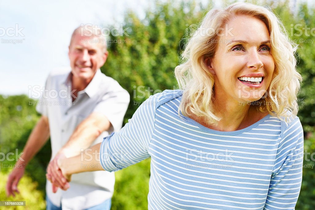 Pretty mature woman holding hand of a senior man royalty-free stock photo