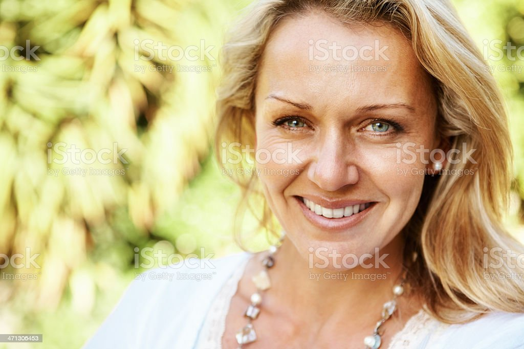 Pretty, mature woman smiling royalty-free stock photo