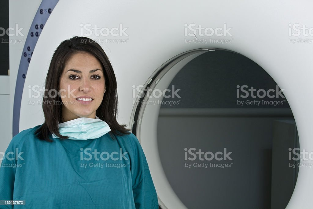 Pretty Medical Student in front of CAT Scan Machine royalty-free stock photo