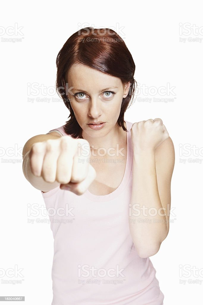 Pretty middle aged woman giving you a fight against white royalty-free stock photo